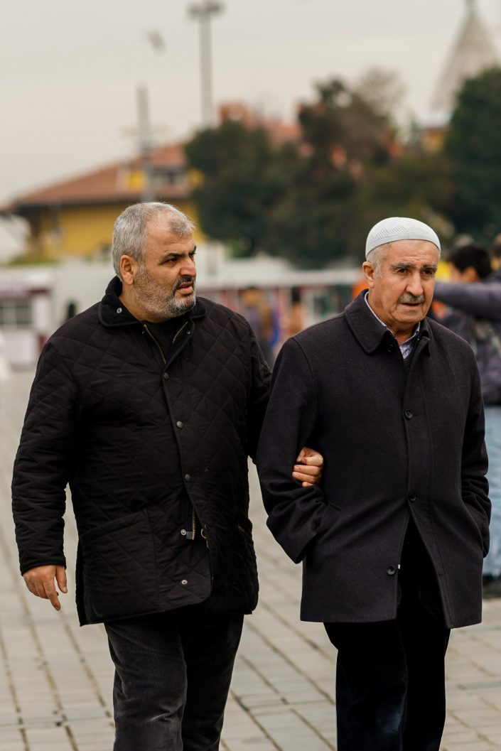 Turkish father and son arm in arm in Istanbul