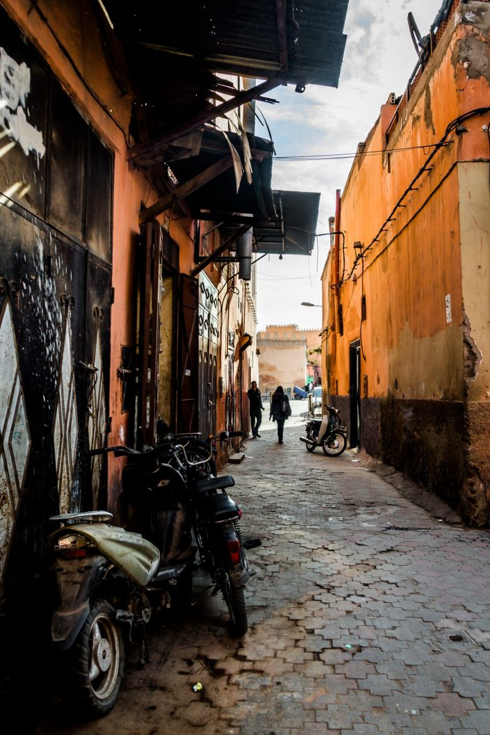 Marrakesh side narrow street showing motorbikes
