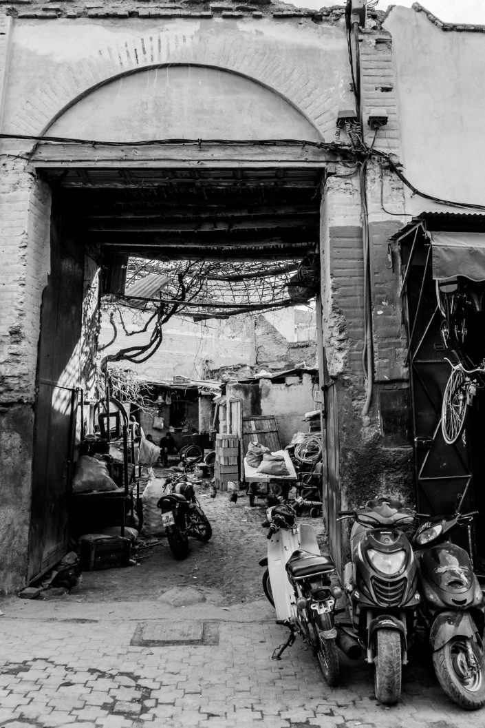 Alley View of an old car repair shop, men sitting