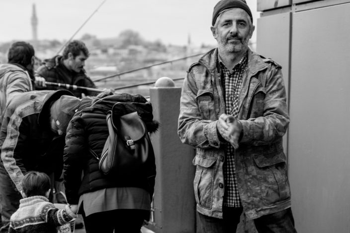 Istanbul Harbour, Fisherman cleaning hands