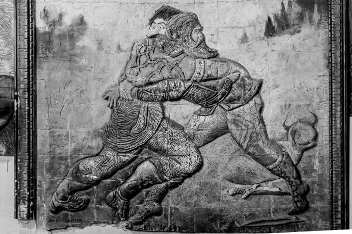 Zoorkhaneh Stone relief of 2 men fighting