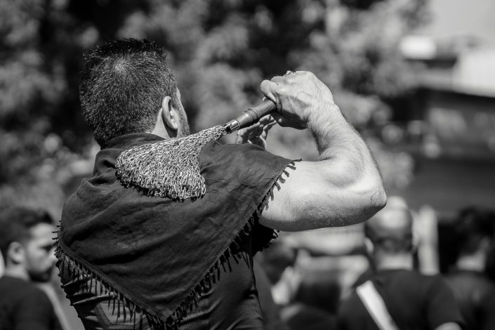 Strong Man holding chains during Ashura