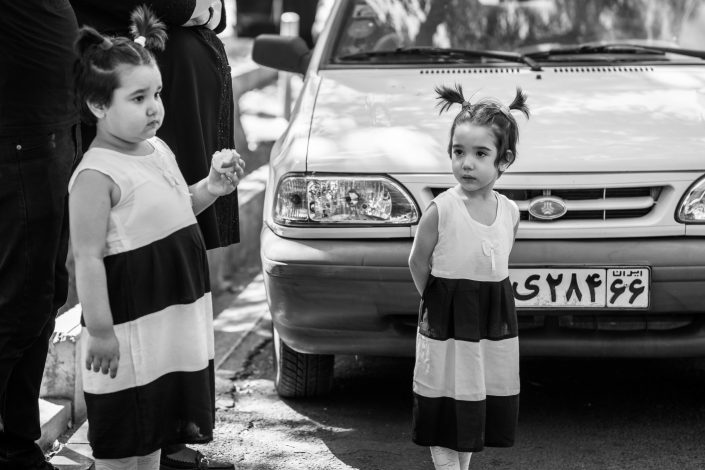 Two little girls identically dressed during Ashura, Iran