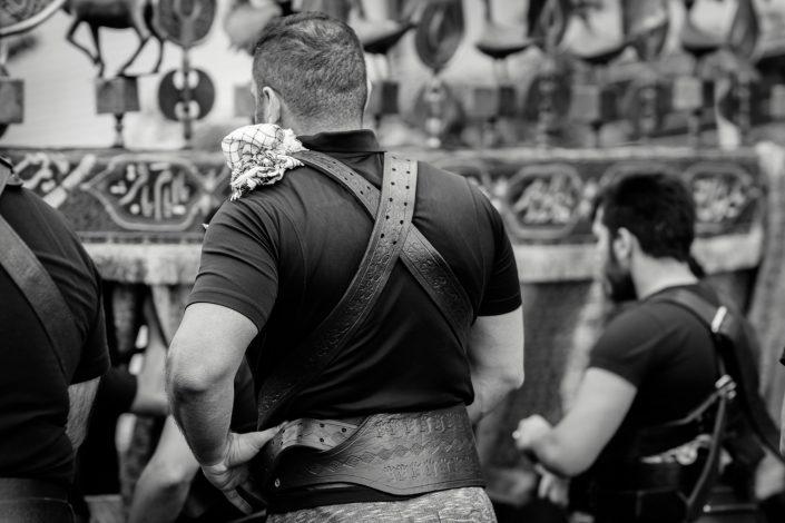 Muscled strong men during Ashura, Iran