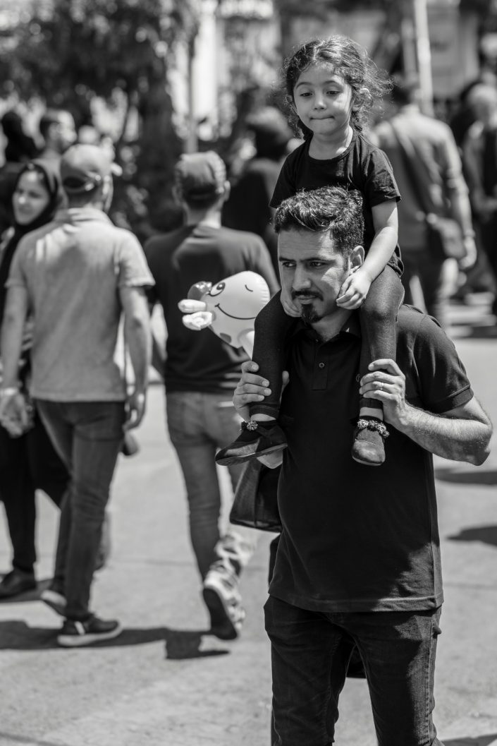 Father holding daughter in his shoulders, Ashura