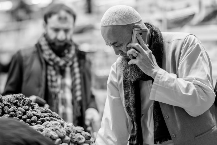 Turkish Imam on the phone, Istanbul bazar