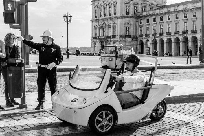 Lisbon Policeman giving directions, Miniature car bring driver by man