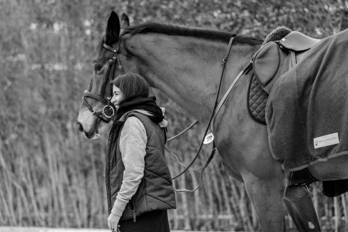 Iranian female horse rider taking her horse