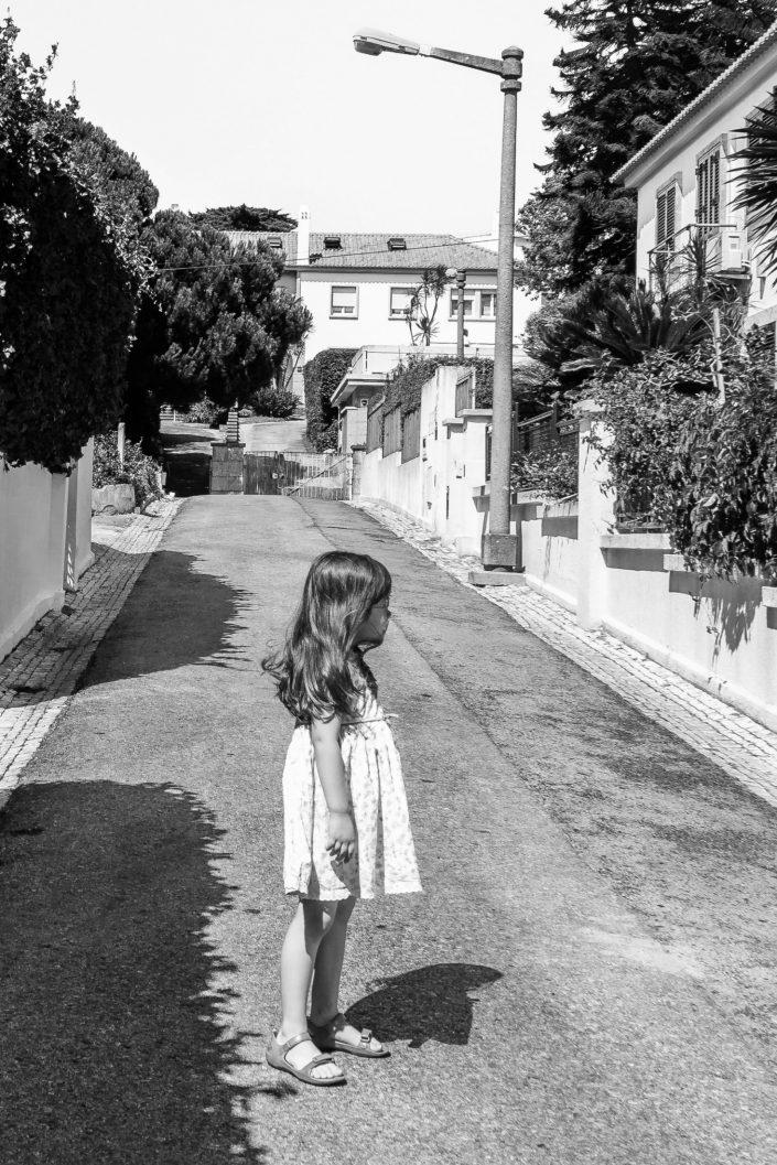 Little girl standing in a Lisbon street