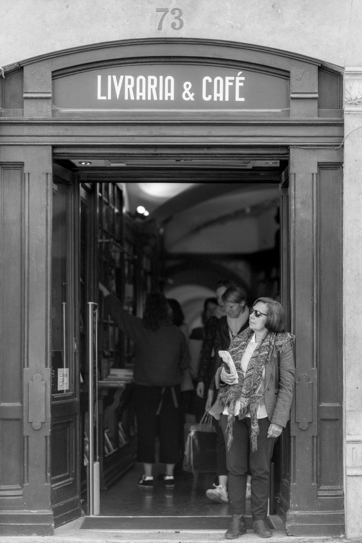 Woman standing at the door of a bookshop, Lisbon