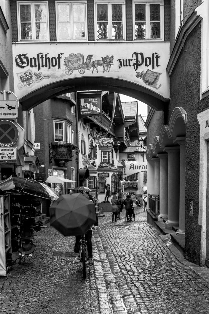 Cyclist hiding face with umbrella, Tyrol, Austria