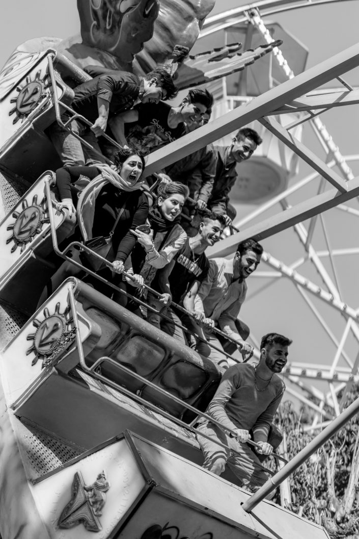 Young woman screaming, amusement park, Iran
