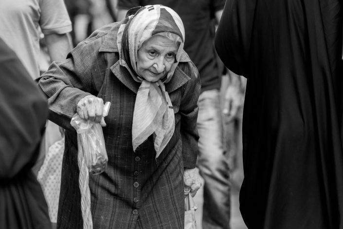 Old lady with cane shopping, Tajrish Bazar, Iran