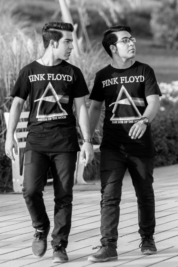 Two identical youth wearing matching Pink Floyd t-shirts