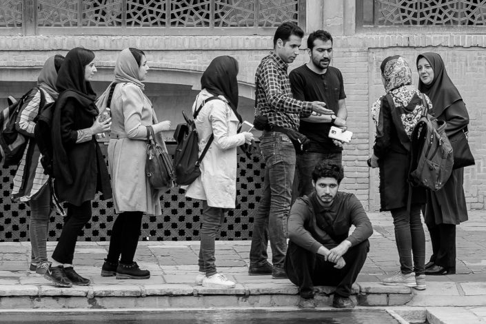 Sad Young university student among loud group Iran