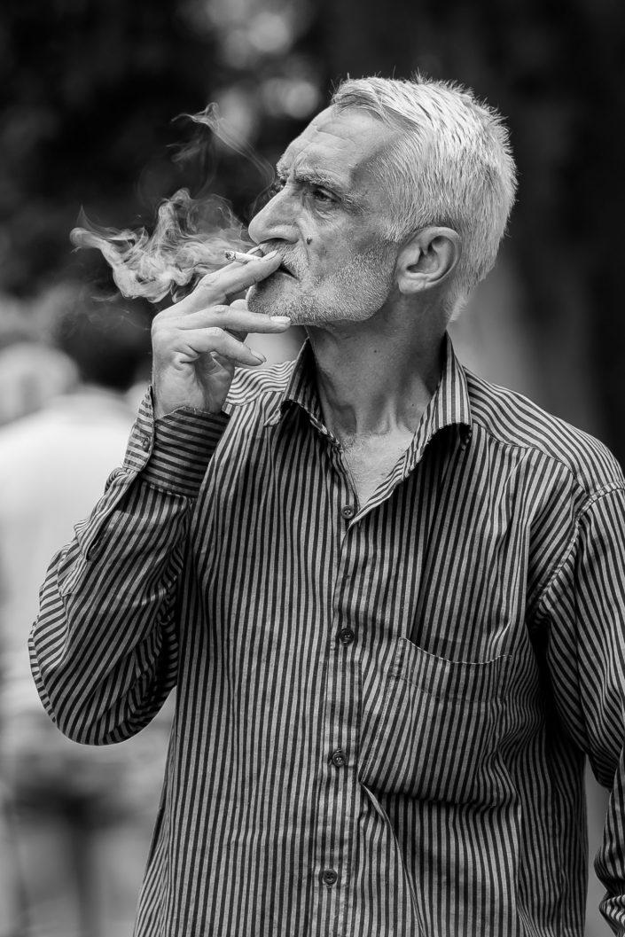 Man smoking in park, Iran