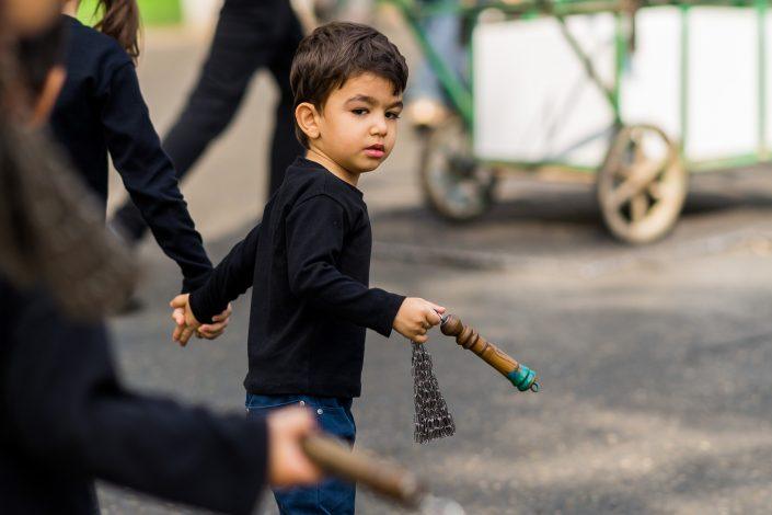 Little boy holding a Ashura chain upside down, Iran