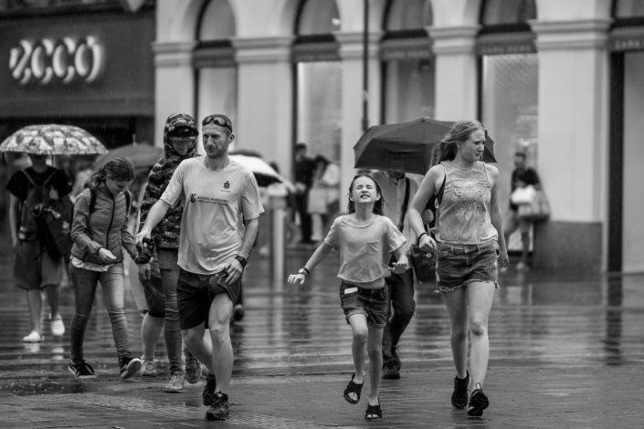 People running from summer rain in Vienna