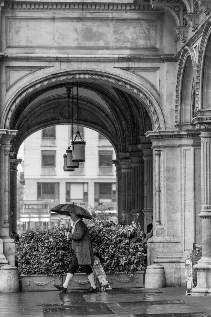 Men dressed with a Mozart costume in the rain in Vienna, Austria