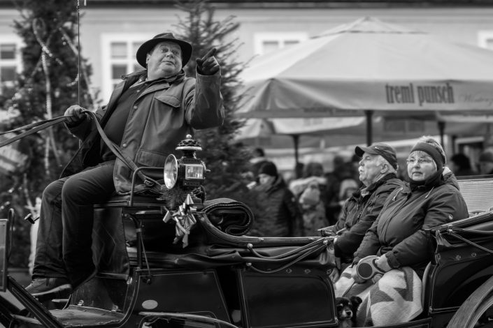 Salzburg carriage with the Coachman pointing and a couple looking elsewhere