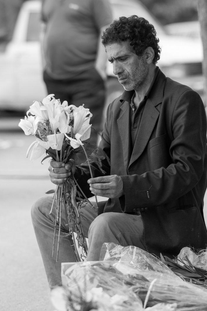 Flower market seller arranging bouquets, Iran