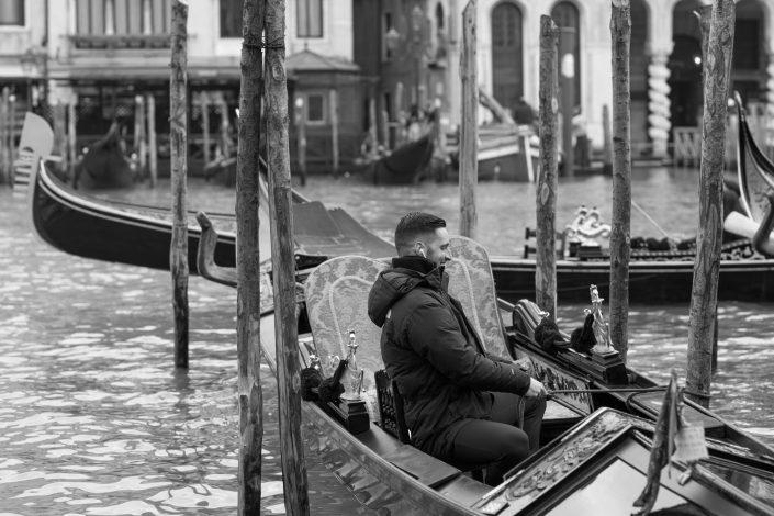 Gondolier tying the gondola