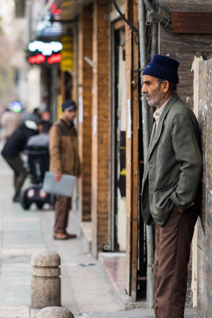 Iranian man with hat streets Tehran