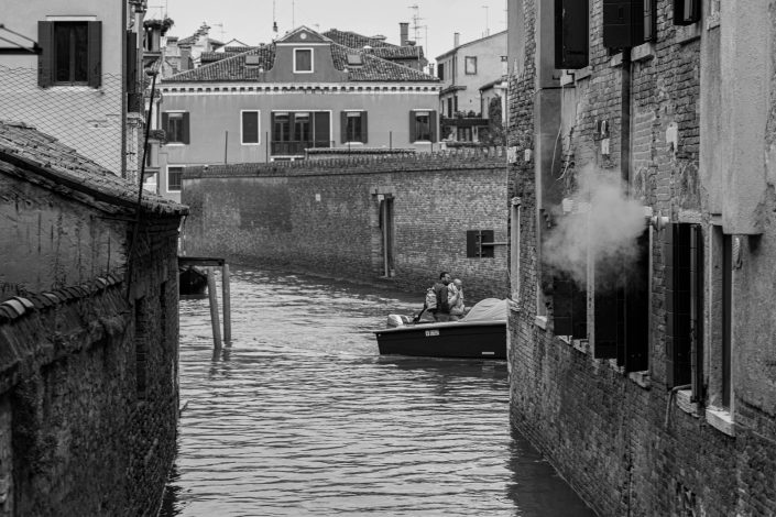 Venice boat transporting merchandise in the canals
