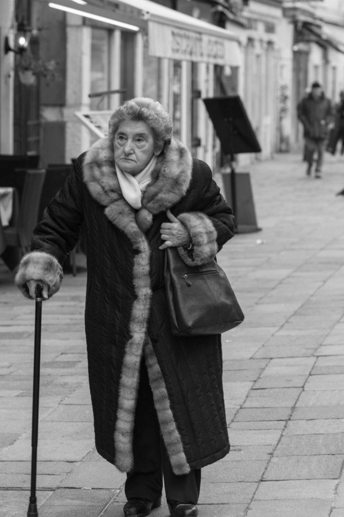 Venice old woman walking in the street
