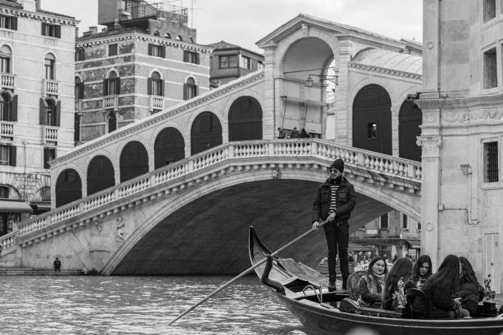 Venitian gondolier wearing sunglasses and hat